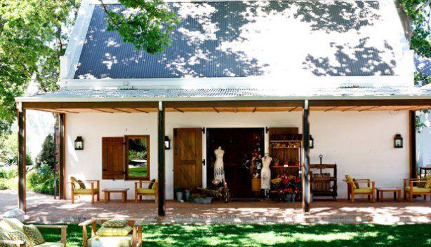 The plaaswinkel / farm shop at La Motte Wine Estate in Franschhoek. Pierre Cronje custom made the doors of the plaaswinkel as well as the shopfitting of the interior,  Interior Design by Christiaan Barnard.