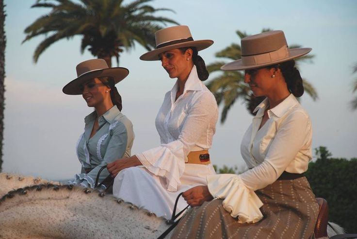 Festivities in Seville, Spain...horse capital of Europe. Women wear their finest tradition Spanish equestrian dressage ensembles and show off their horses in this ages old Spanish festival. BEAUTIFUL!