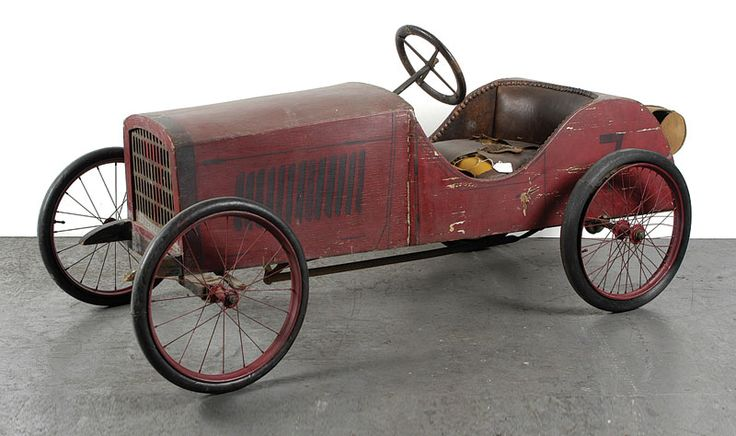 "Italian manufacture wooden Pedal Car model of the ""Italia"" with upholstered seat, rear canvas carrier bag, spoked wheels, solid tyres, produced in the 1920s, overall length is 5' 4"", width 27"" and height 29"". Splendid example of early Italian Pedal Cars, is very hard to find and largely in original condition"