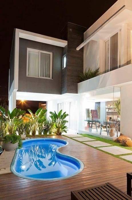 Casa AP+VP: Piscinas modernas por ANDRÉ PACHECO ARQUITETURA
