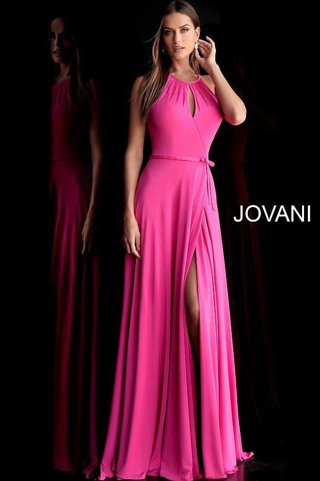 1b3dcecebcf Hot pink halter neck gown with keyhole detail. High slit