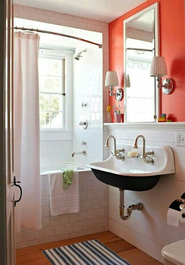 bathroom cabinet online design tool%0A small white bathroom with coral accent wall  wood floor  curved shower rod   Small Bathroom Chic  Small Spaces with Big Style from Bathroom Bliss by  Rotator