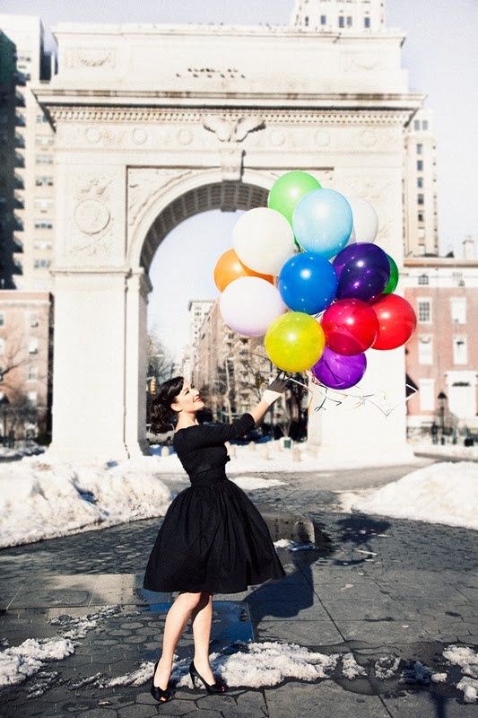 black dress, colorful balloons