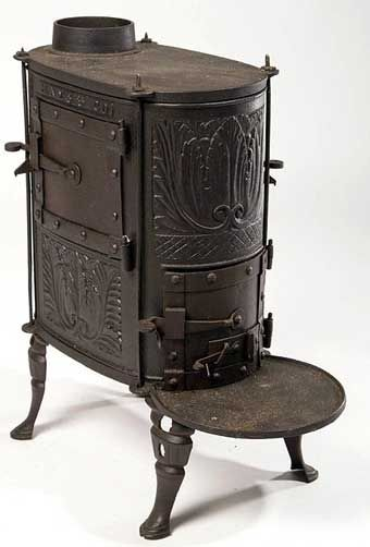 """PENNSYLVANIA CAST-IRON DIMINUTIVE HEATING STOVE, marked """"HAYS & CO"""", cast at the Hays (Charlotte) Furnace, Perry Co., PA, three hinged lift-off doors, raised on four hoof-like feet. Brass plaque mounted on the stove is engraved """"From Cedar Grove / Isaac W. and Sarah Morris / About 1796 / John T. and Lydia T. Morris"""". First quarter 19th century."""