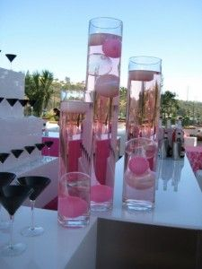 Centerpiece idea: use tall vases with food coloring and small objects