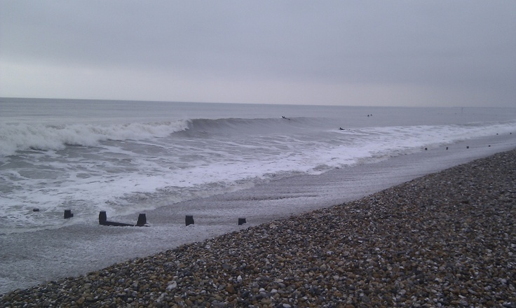 """""""I love surfing, but live in the UK, so I get to see beaches on cold wet miserable days that aren't the usual beach-going weather. But I love the atmosphere of a grey day on the beach, and of course it doesn't affect the waves!"""" - James (Bracklesham Bay, Sussex, UK)"""