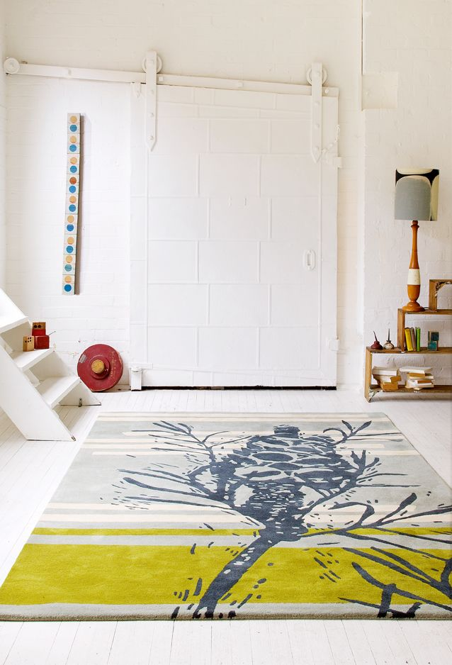 Banksia rug by Julie Patterson, warming up a warehouse remodel space.