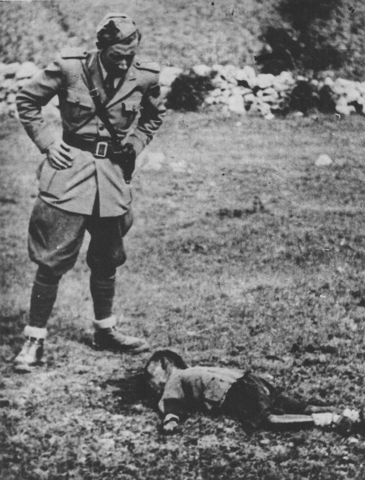 1943 Yugoslavia Goražde (now Bosnia and Herzegovina), An Italian officer looks at the   corpse of a murdered child  Louie Diana