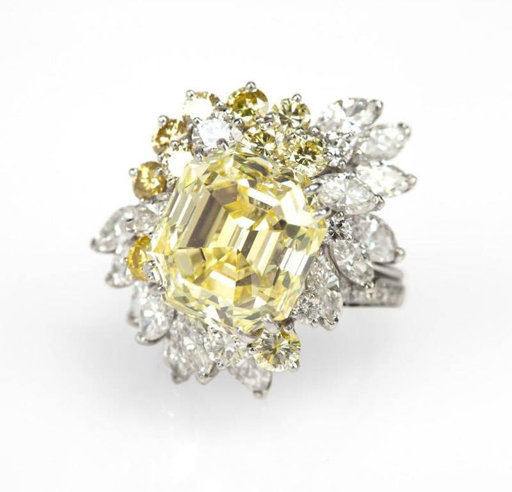 A natural fancy yellow diamond and platinum ring - Price Estimate: $200000 - $250000