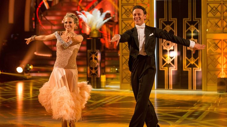 Programme website: http://bbc.in/1M55hdN Kellie Bright and Kevin Clifton American Smooth to 'Let's Face The Music and Dance' by Nat King Cole.