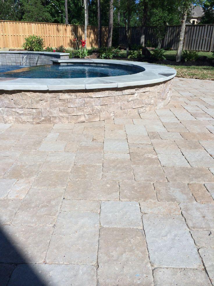 Inground swimming pool/Split face tile raised spa
