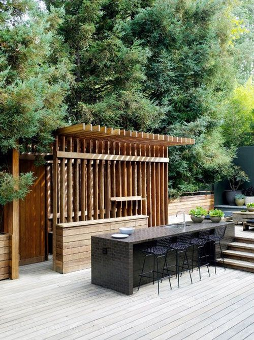 External kitchen inspiration, with dark island design against timber and the natural backdrop - Found on Pinterest