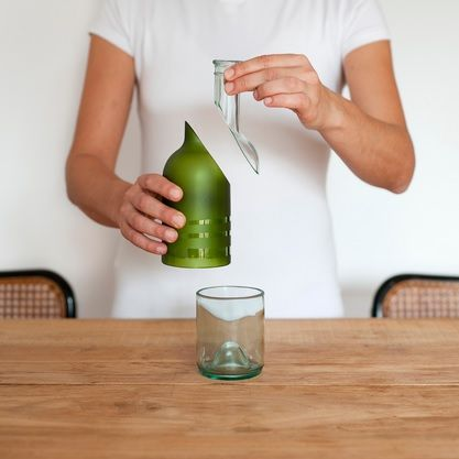 A Bottle Design That Turns Into A Drinking Glass, Lantern And Spoon - DesignTAXI.com