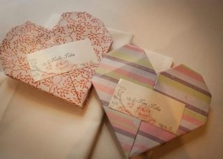 Origami heart place cards...everyone loved these, cheap as chips!