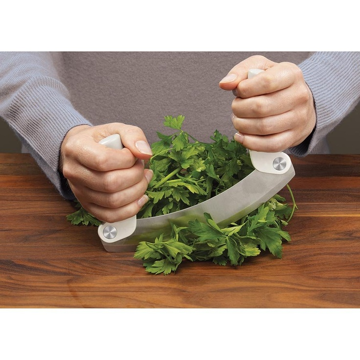 Mezzaluna - Folding Herb Chopper Integrated Blade Guard  Taking its name from the Italian word for 'half moon', this traditional utensil for chopping herbs is updated with a design that is both safer and more compact than the original. It has pivoting handles and a sharp stainless-steel blade that slices through fresh herbs and garlic with ease. After use the handles can be folded back over the blade making it perfect for storing in a drawer.