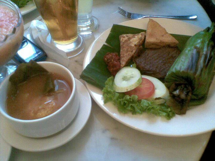 Sour Vegetables Soup with banana leave wrapped rice, fried soybean cake, fried tofu & fried beef