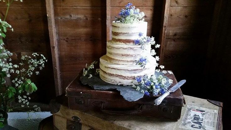 Naked Wedding cakes are the most elegant centre piece for a rustic wedding, or in deed any wedding, but they are sublime. This one was made by Jane at Crocket Cakes for a wedding shoot at The Cow Shed.