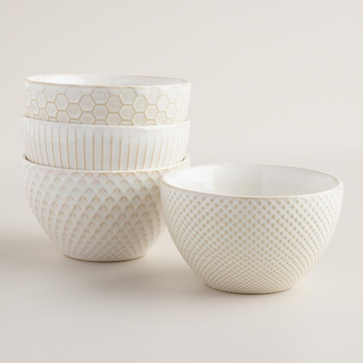 Bring a casual cafe vibe to your table setting with our stoneware bowls. In four textured designs, these off-white bowls are beautiful on their own or mixed with other dinnerware for an eclectic flair.