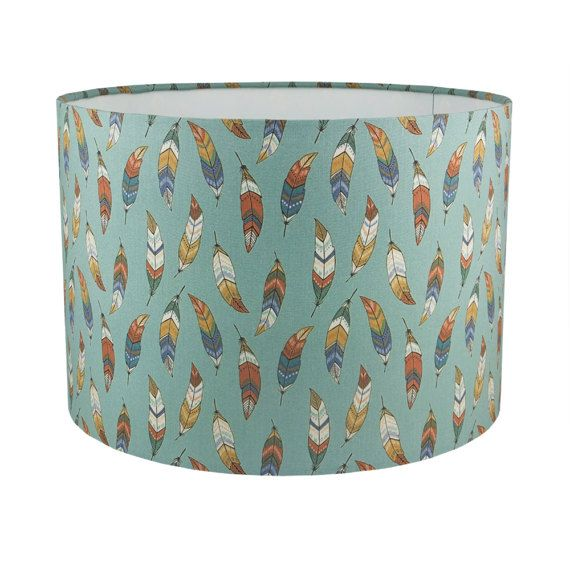 This handmade, fabric lampshade has a duck egg blue background & is covered in beautiful feathers in blue, green, brown & white. It will complement many different colour schemes & would make a perfect reading light, or can be hung as a ceiling shade. A diffuser can be used in a ceiling-hung shade to prevent glare from the bulb. Available to buy separately here: https://www.etsy.com/listing/232485646/translucent-diffuser-for-ceiling?ref=shop_home_active_1  If you would like a small free…