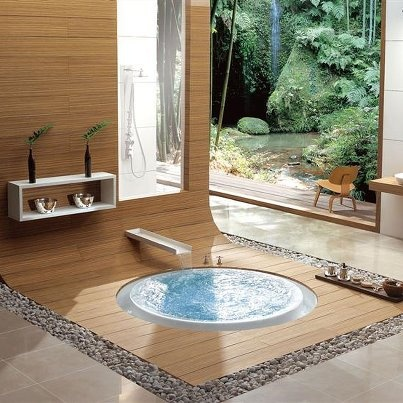Not round, and larger, and the waterfall in should be higher ...but I could go for this, with the outdoor spring too.