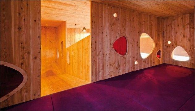 Josef-Felder-Strasse Kindergarten designed by Hiendl Schineis Architekten in Germany. Ramps, colour and hide-away spaces.
