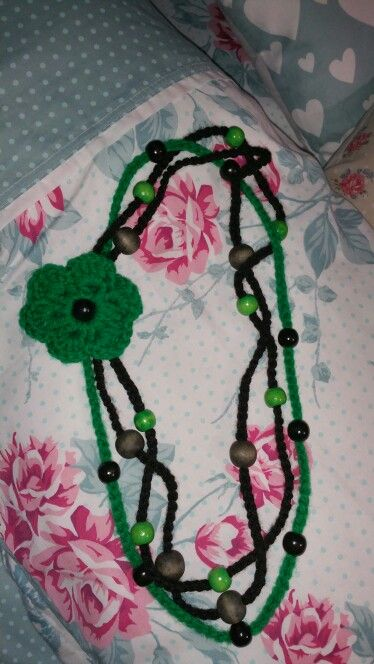 Crochet strings with green and black beads and green flower