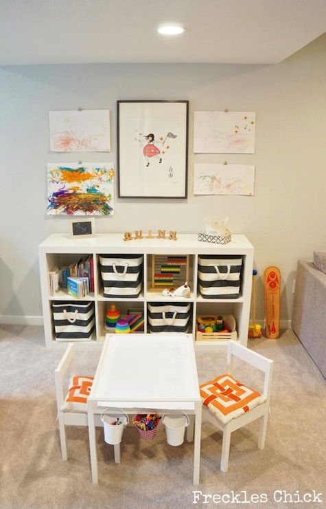 source: Freckles Chick website Chic playroom featuring Ikea Expedit Shelving Unit filled with The Container Store Rugby Stripe Bins, toys and books. Ikea Latt Children's Table and Chairs with Target pillows doubling as cushions.