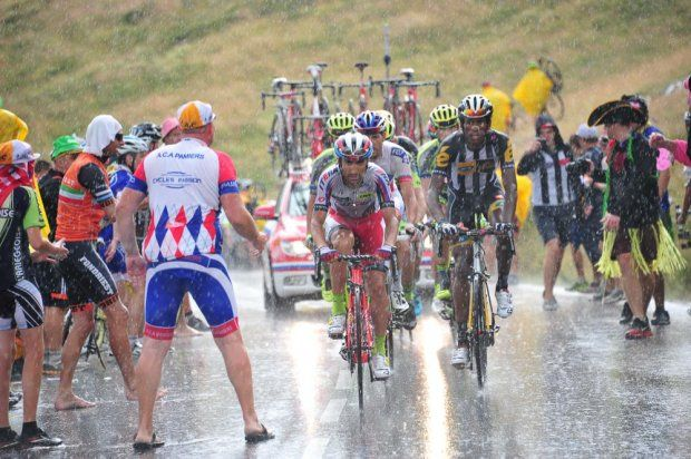 Machado and Teklehaimanot in the rain. Stage 12,  Lannemezan to Plateau de Beille.