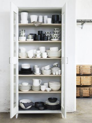 keeping dishes here keeps the kitchen minimal while also allowing for all the dishes to be viewed at the same time.