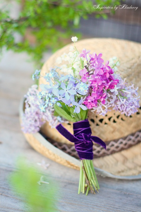 Posy of lilac and forget me nots tied with velvet