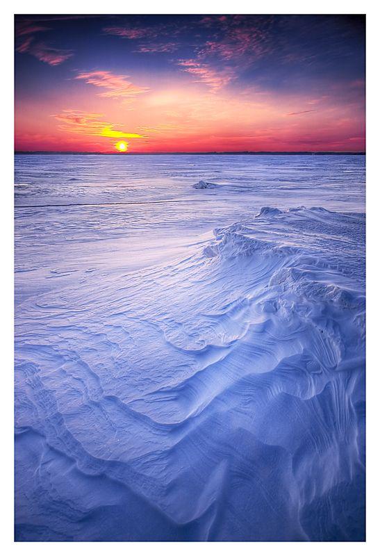 sunset at Oulunlahti on the sea ice in Oulu, Finland