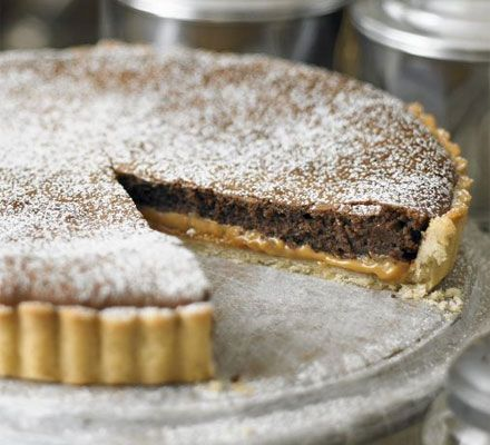 Millionaire's chocolate tart. Very popular - for the caramel I used condensed milk, and sprinkled over a teaspoon of Maldon sea salt before adding the chocolate layer.