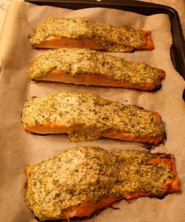 Roasted Salmon with Herbed Yogurt  1/2 cup Greek yogurt (2 %)  2 Tbsp Dijon mustard  2 Tbsp finely chopped fresh dill  2 Tbsp finely chopped fresh parsley  coarse salt and ground pepper  1 side of salmon (3 pounds) or 8 fillets (6 oz each)  lemon wedges, for serving