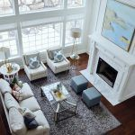White Living room with tall fireplace room furniture and decor layout. By Sita Montgomery