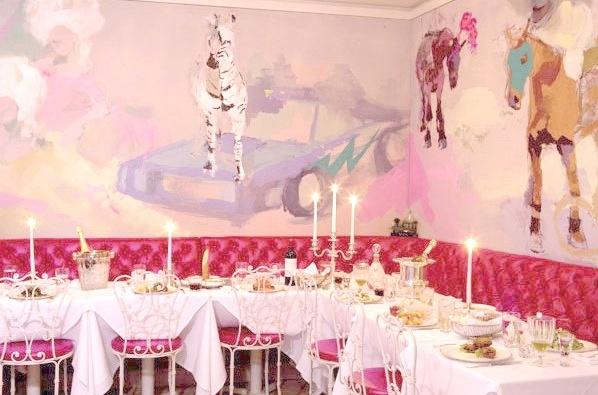 Fabulous pink booth and muraled wall at Sweetie Pie Restaurant NYC