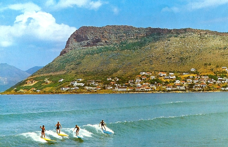 Photograph of Surfers in the 1960's at Fish Hoek beach, Cape Town, South Africa. (Scanned from a rare travel brochure printed in the 1960's)