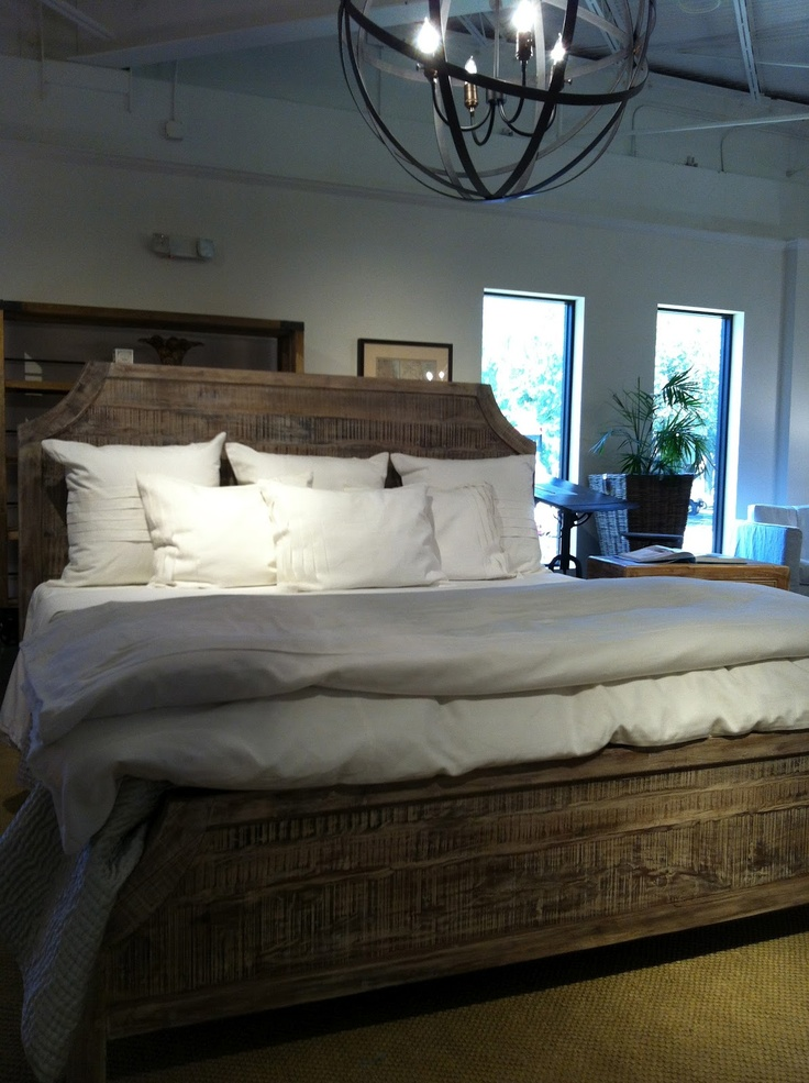 reclaimed/whitewashed wood bed with crisp white linens.