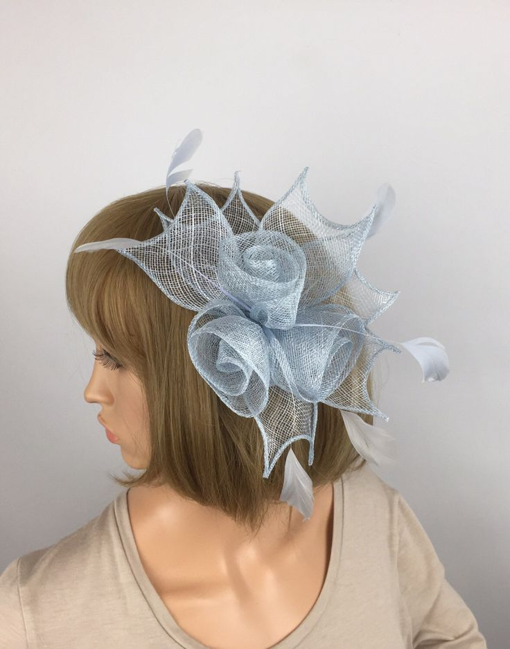 A personal favourite from my Etsy shop https://www.etsy.com/uk/listing/518748372/pale-blue-fascinator-baby-blue-comb