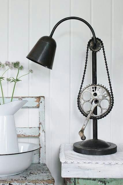What an interesting way to add some details to an otherwise plain table lamp. The bicycle chain adds a nice flair and accentuates the curved lines found on the lamp.