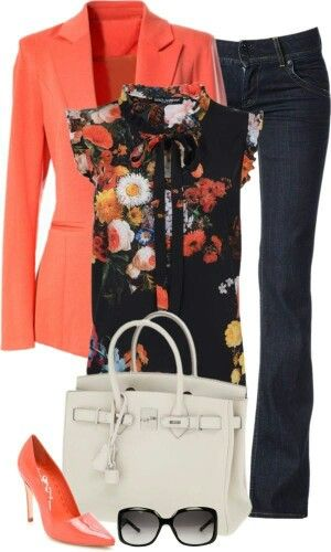 Coral Blazer with floral print and navy denim pants.