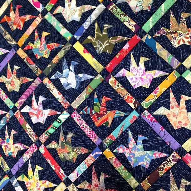 """peace quilt"" by scrappy quilts, cute! origami flapping birds done in exotic japanese print fabrics against a indigo blue sashiko-worked background"