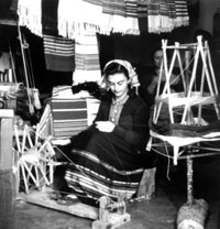 The weavers, the looms, the spinning wheels, the products, the heyday of the textile of Mikonos.     Photo by Voula Papaioannou