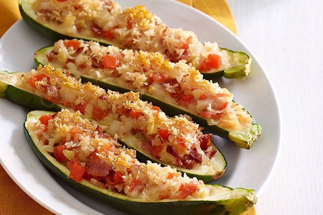 Fill this Stuffed Zucchini with tomatoes, onions, bacon & cheese. Then, top the Stuffed Zucchini with golden-brown panko crumbs to add even more flavor.