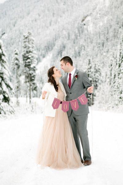 Wishing for kisses atop newly fallen snow: http://www.stylemepretty.com/washington-weddings/2015/01/27/romantic-winter-wedding-inspiration/ | Photography: Nikki Closser - http://www.nikkiclosser.com/