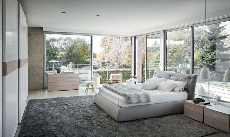 Open Space Bedroom Design With Large Glass Wall Plus White Bedding And Black Fur Rug And Wooden Dresser Bedrooms Design Ideas: The Development of Ideas Bedroom design