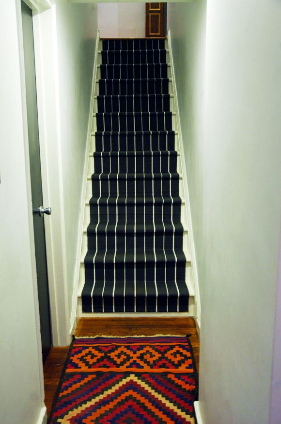 Small Ikea rugs as stair runners! love!!! Little Green Notebook: DIY: Stair Runner