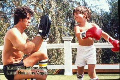 "Sylvester ""Rocky"" Stallone teaching his son boxing. The kid looks like he throws shots with bad intentions.  Boxing Hall of Fame - Google+  boxinghalloffame.com"