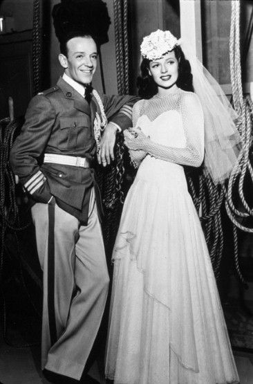 Rita Hayworth marries Fred Astaire in film 'You'll Never Get Rich', 1941 Hollywood beauty Hayworth looked ravishing in her wedding dress with beaded fishnet sleeves in the 1941 film 'You'll Never Get Rich' in which she married Fred Astaire....