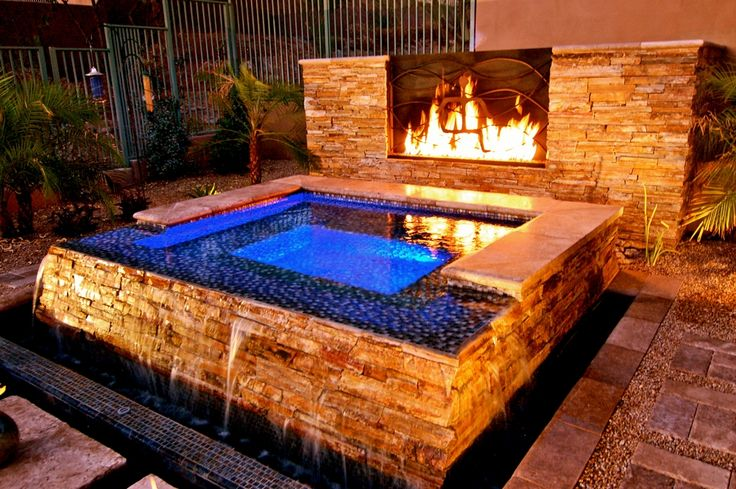 stunning backyard hot tub with water fall