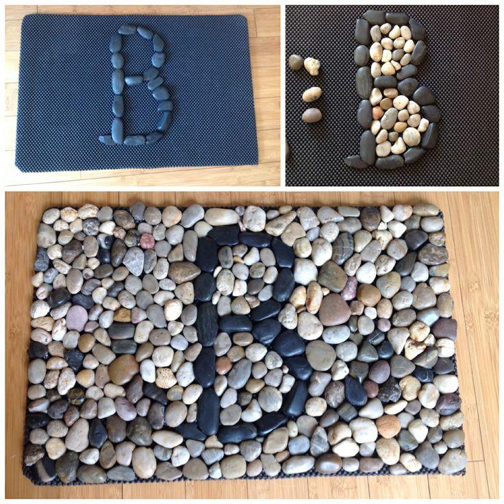 River rock DIY monogrammed door mat.    Nice welcome initial mat.